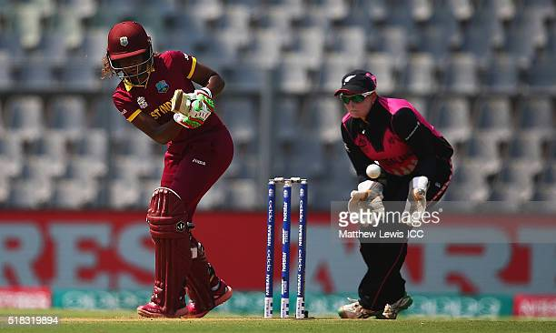 Hayley Matthews of the West Indies hits the ball towards the boundary as Rachel Priest of New Zealand looks on during the Women's ICC World Twenty20...