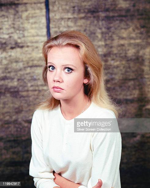 Hayley Mills British actress poses wideeyed wearing a white woollen jumper in a studio portrait circa 1965