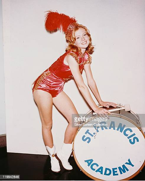 Hayley Mills British actress wearing a red majorette costume and posing beside a bass drum which bears the legend 'St Francis Academy' in a publicity...
