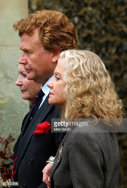 Hayley Mills her brother Jonaphan and sister Juliette follow their father's coffin actor Sir John Mills to his last resting place after his funeral...