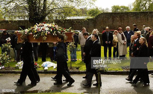 Hayley Mills her brother Jonathan and sister Juliette follow their father's coffin actor Sir John Mills during his funeral service at the church of...
