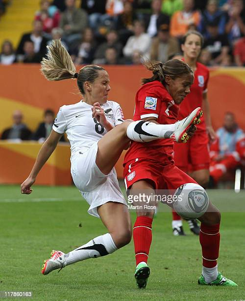 Hayley Moorwood of New Zealand and Alex Scott of England battle for the ball during the FIFA Women's World Cup 2011 Group B match between New Zealand...