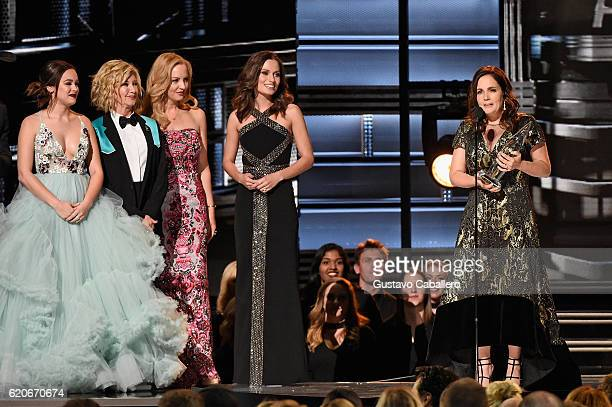 Hayley Orrantia Olivia NewtonJohn and Wendi McLendonCovey present Lori McKenna with the Song of the Year award onstage at the 50th annual CMA Awards...
