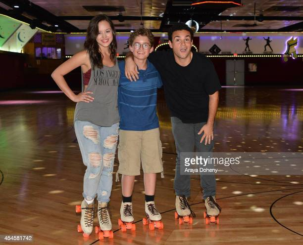 Hayley Orrantia Sean Giambrone and Troy Gentile attend 'The Goldbergs' press event held at Moonlight Rollerway on September 3 2014 in Glendale...