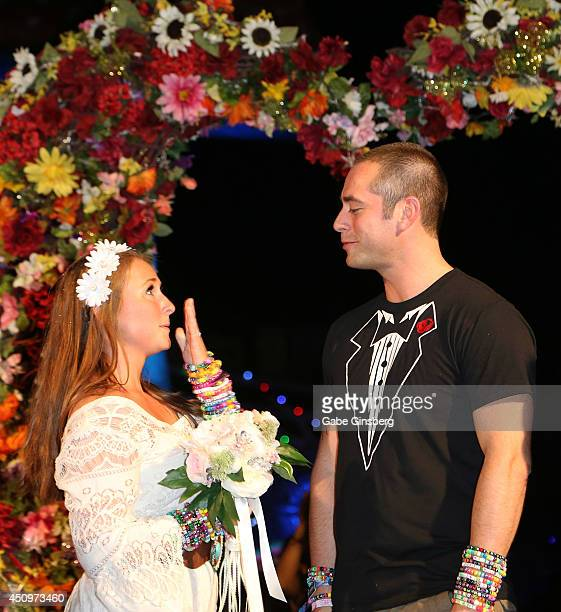 Hayley Parsons marries John Anderson at the wedding chapel during the 18th annual Electric Daisy Carnival at Las Vegas Motor Speedway on June 20 2014...