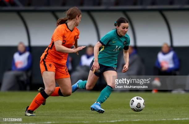 Hayley Raso of Australia breaks past Aniek Nouwen of Netherlands during the International Friendly match between Netherlands Women and Australia...