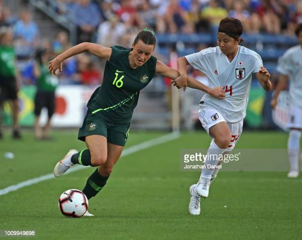 Hayley Raso of Australia holds off Narumi Miura of Japan during the 2018 Tournament Of Nations at Toyota Park on August 2 2018 in Bridgeview Illinois...