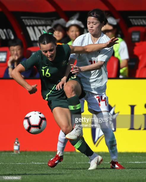Hayley Raso of Australia knocks the ball away from Yui Hasegawa of Japan during the 2018 Tournament Of Nations at Toyota Park on August 2 2018 in...