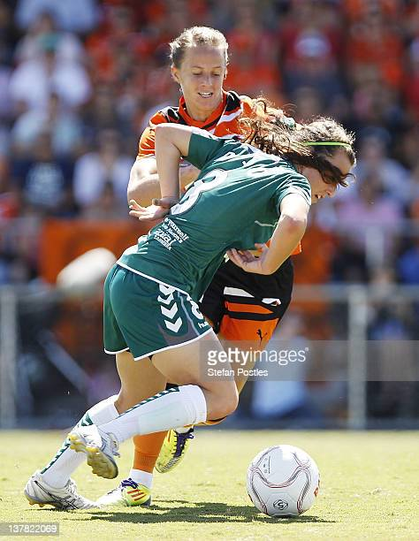 Hayley Raso of Canberra United and Aivi Luik of Brisbane Roar contest possession during the 2012 WLeague Grand Final match between Canberra United...