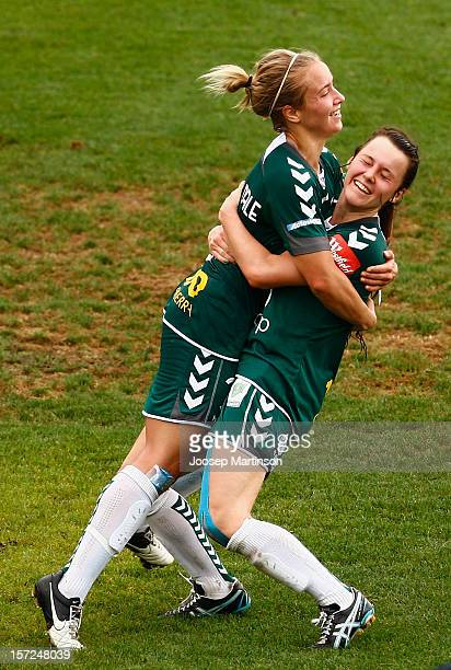 Hayley Raso of Canberra United congratulates Georgia Yeoman-Dale for scoring a goal during the round seven W-League match between Sydney FC and...
