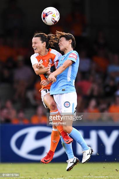 Hayley Raso of the Roar and Yukari Kinga of Melbourne City compete for the ball during the W-League Semi Final match between the Brisbane Roar and...