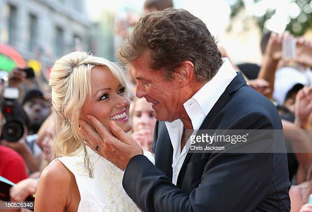 Hayley Roberts and actor David Hasselhoff attend the world premiere of Keith Lemon The Film at the Odeon West End on August 20 2012 in London United...