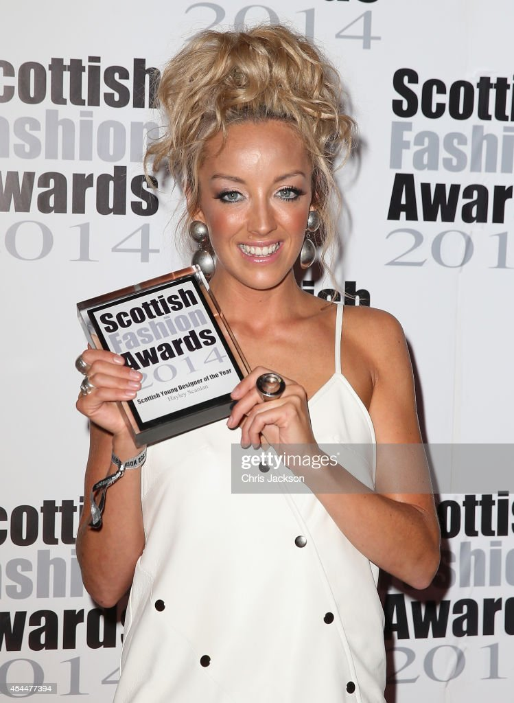 Hayley Scanlan poses with the ScottishYoung Designer of the Year Award as she attends The Scottish Fashion Awards on September 1, 2014 in London, England.