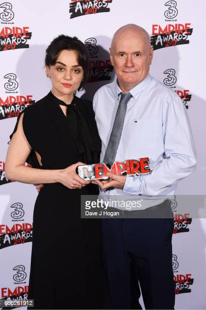 Hayley Squires and Dave Johns pose with the award for Best Male Newcomer in the winners room at the THREE Empire awards at The Roundhouse on March 19...