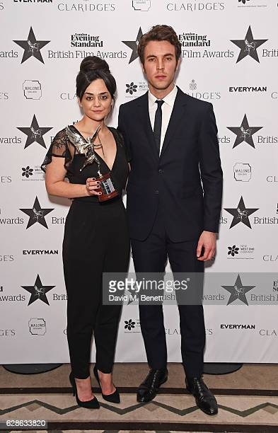 Hayley Squires winner of the Best Supporting Actress award for 'I Daniel Blake' and presenter Tom Hughes pose at The London Evening Standard British...