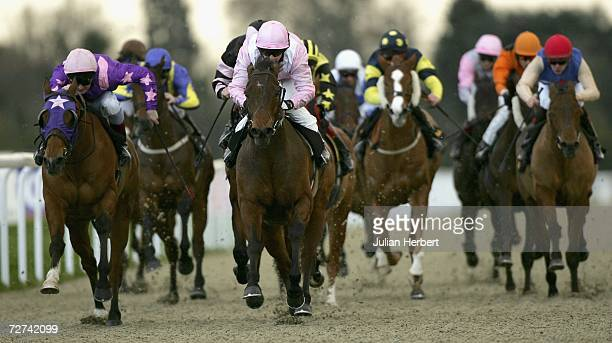 Hayley Turner and Davids Mark lead the field home to land The Kempton For Team Building Banded Stakes Race run at Kempton Racecourse on December 6...