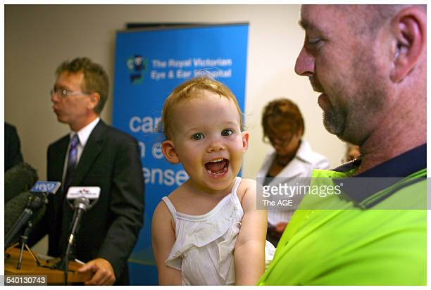 Hayley Walsh 20 months is all smiles in the arms of Dad Trevor Walsh after her Cochlear Implant Hayley was born profoundly deaf and was Victoria's...