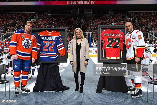 Hayley Wickenheiser Connor McDavid and Mark Giordano pose for a photo prior to the game between the Edmonton Oilers and the Calgary Flames on January...