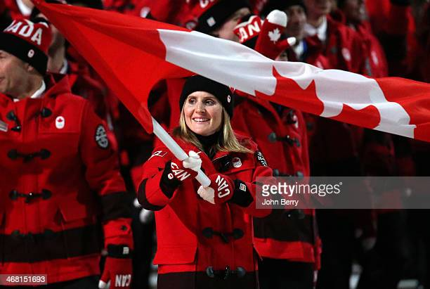 Hayley Wickenheiser is the flag bearer for Canada during the Opening Ceremony of the 2014 Winter Olympic Games at the Fisht Olympic Stadium on...