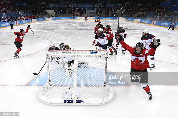 Hayley Wickenheiser of Canada celebrates a goal in the third period against Jessie Vetter of the United States during the Women's Ice Hockey...