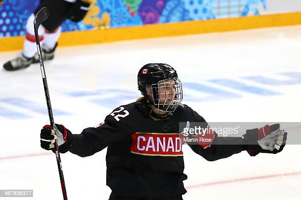Hayley Wickenheiser of Canada celebrates after scoring a goal against Florence Schelling of Switzerland in the second period during the Women's Ice...