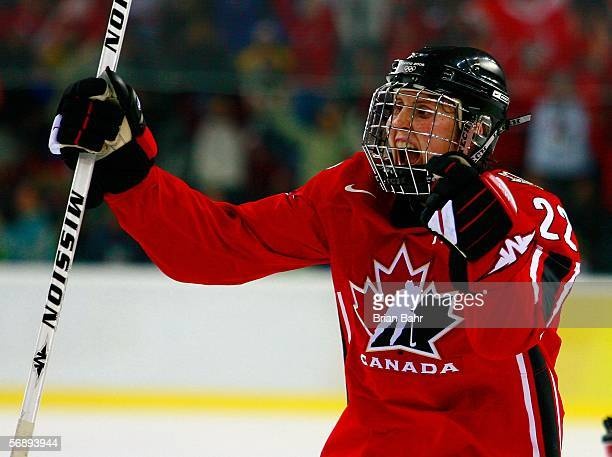 Hayley Wickenheiser of Canada celebrates teammate Gillian Apps' first period goal to make the score 10 over Sweden during the final of the women's...