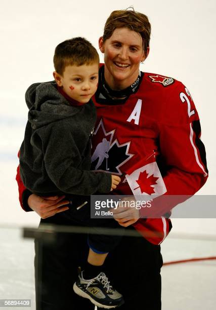 Hayley Wickenheiser of Canada celebrates with her son Noah after their 4-1 victory over Sweden to win the gold medal in women's ice hockey during Day...