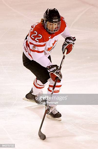 Hayley Wickenheiser of Canada controls the puck as she skates against the USA during their Women's Ice Hockey match at the Magness Arena on the...