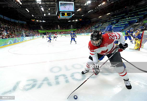Hayley Wickenheiser of Canada controls the puck during the ice hockey women's preliminary game between Canada and Sweden on day 6 of the 2010 Winter...