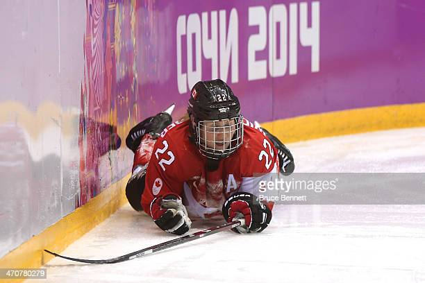 Hayley Wickenheiser of Canada falls during the Ice Hockey Women's Gold Medal Game on day 13 of the Sochi 2014 Winter Olympics at Bolshoy Ice Dome on...