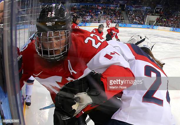 Hayley Wickenheiser of Canada fighs for position against the boards with Josephine Pucci of the United States in the second period during the Women's...
