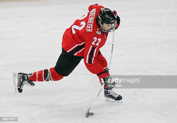 Hayley Wickenheiser of Canada hits a slap shot against Finland in the second period during the women's ice hockey semifinals on Day 7 of the Turin...