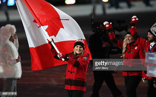 Hayley Wickenheiser of Canada is the flag bearer during the Opening Ceremony of the 2014 Winter Olympic Games at the Fisht Olympic Stadium on...