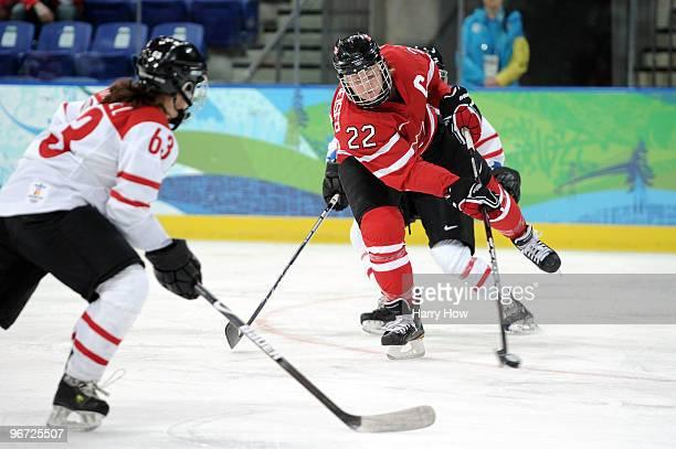 Hayley Wickenheiser of Canada skates with the puck during the Women's preliminary ice hockey game between Switzerland and Canada on day 4 of the...