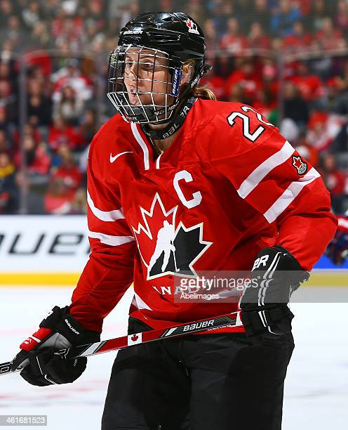 Hayley Wickenheiser of Team Canada skates up the ice against Team USA during a Sochi preparation game at the Air Canada Centre December 30 2013 in...