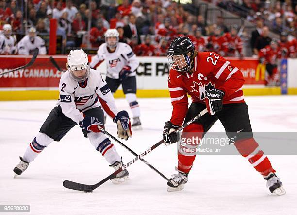 Hayley Wickenheiser of Team Canada skates with the puck against Jenny Potter of Team USA at Scotiabank Place on January 1 2010 in Ottawa Canada