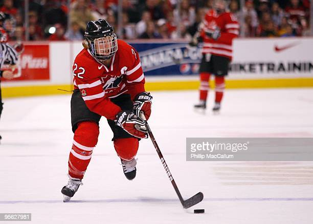 Hayley Wickenheiser of Team Canada skates with the puck during the game against Team USA at Scotiabank Place on January 1 2010 in Ottawa Canada