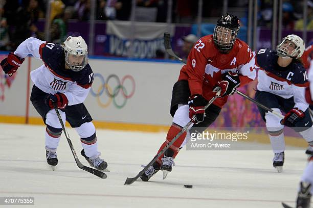 Hayley Wickenheiser of the Canada controls the puck against the USA the second period of the women's gold medal ice hockey game Sochi 2014 Winter...