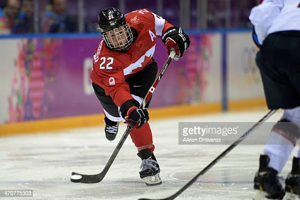 Hayley Wickenheiser of the Canada takes a shot against the USA during the second period of the women's gold medal ice hockey game Sochi 2014 Winter...