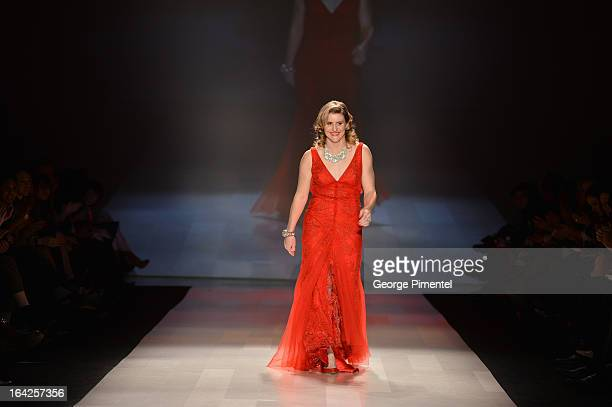 Hayley Wickenheiser walks the runway wearing Something Blue for the Heart and Truth fashion show during World MasterCard Fashion Week Fall 2013 at...