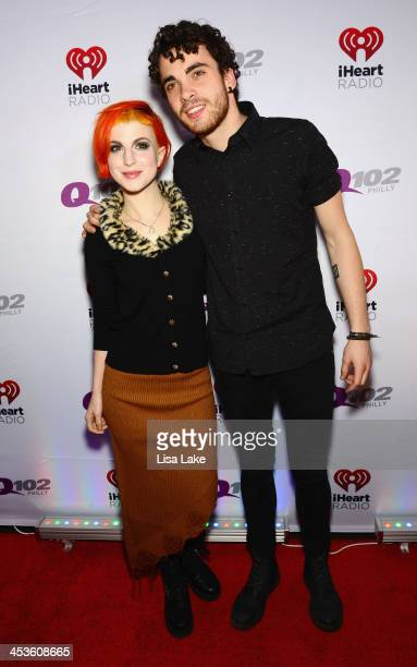 Hayley Williams and Taylor York of Paramore attends Q102's Jingle Ball 2013 presented by Bernie Robbins Jewelers at Wells Fargo Center on December 4...