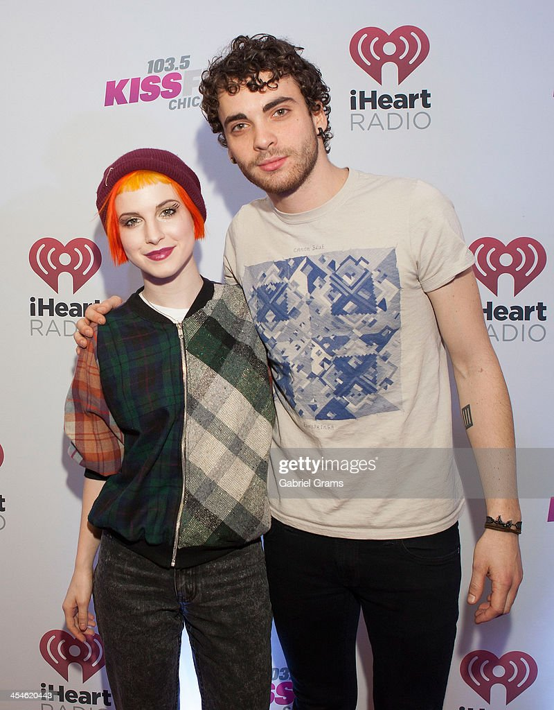 Hayley Williams (L) and Taylor York of Paramore pose in the press room at 103.5 KISS FM's Jingle Ball 2013 at United Center on December 9, 2013 in Chicago, Illinois.