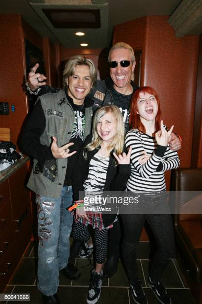 Hayley Williams of Paramore poses backstage with Twisted Sister singer Dee Snider dauughter Cheyenne Snider and son Jesse Blaze Snider contestant for...
