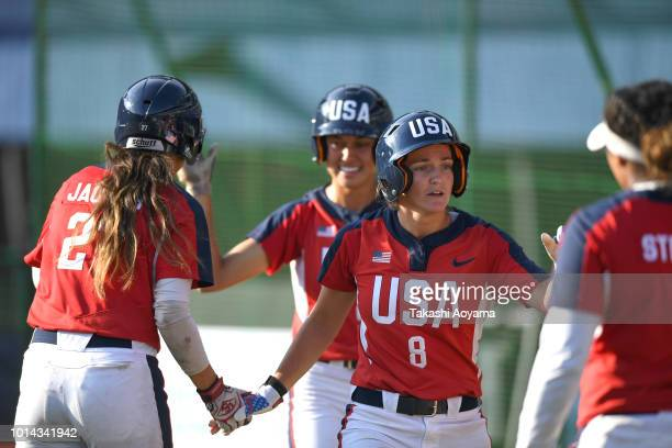 Haylie Ann McCleney celebrates score on a RBI double by elaney Lyn Spaulding of United States in the fifth inning against Australia during their...