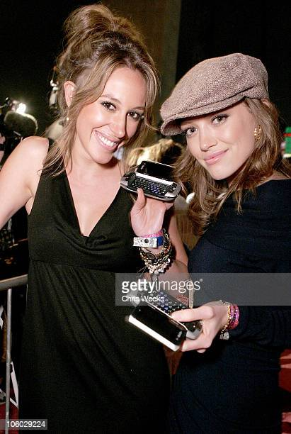Haylie Duff and Hilary Duff during TMobile Sidekick 3 Launch Party Red Carpet at The Paladium in Hollywood California United States