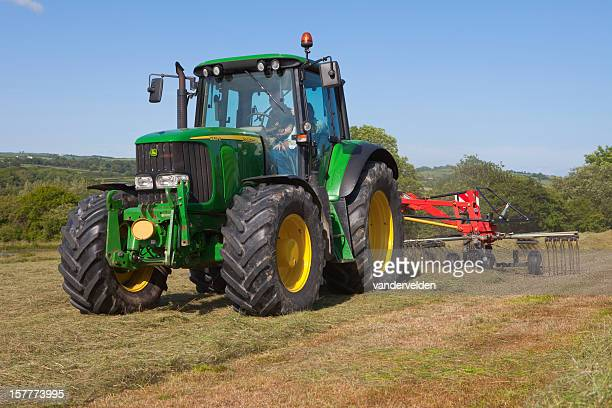 haymaking in summer - john deere stock pictures, royalty-free photos & images