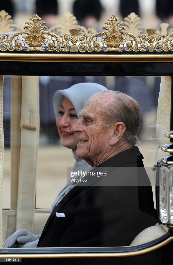 Hayrunnisa Gul (L), wife of Turkey's President Abdullah Gul, rides in a carriage along The Mall towards Buckingham Palace with Prince Philip, Duke of Edinburgh on November 22, 2011 in London, England. The President of Turkey is on a five day State visit to the UK.
