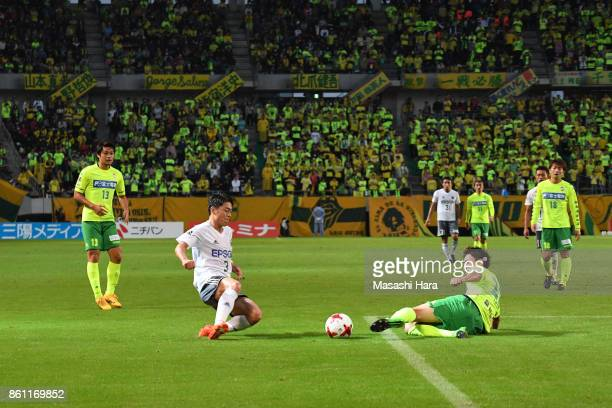 Hayuma Tanaka of Matsumoto Yamaga and Takaya Inui of JEF United Chiba compete for the ball during the JLeague J2 match between JEF United Chiba and...