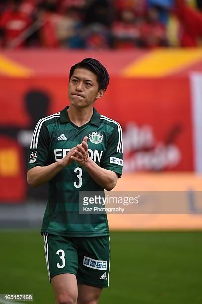 Hayuma Tanaka of Matsumoto Yamaga walks around the stadium to show his thanks during his time in Nagoya during the J League match between Nagoya...