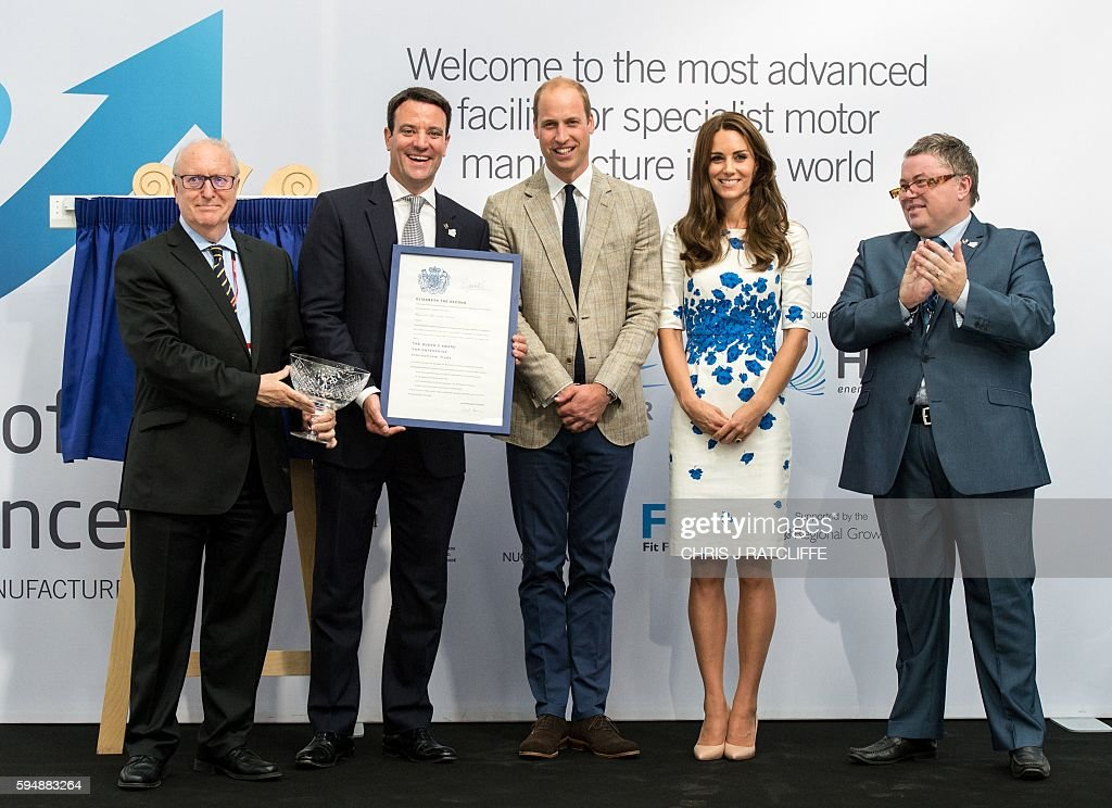 Hayward Tyler Chairman John May, CEO Ewan Lloyd-Baker, Britain's Prince William, Duke of Cambridge, Catherine, Duchess of Cambridge, John Green, General Manager, Luton pose together with The Queen's Award for Enterprise (International Trade) during their Royal Highnesses visit to Hayward Tyler in Luton, north of London, on August 24, 2016. Hayward Tyler designs, manufactures, and services fluid-filled electric motors and pumps for high-pressure, high-temperature applications and environments across the global energy sector. / AFP / CHRIS